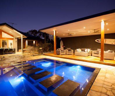 Outdoor pool enteraining area shot at dusk